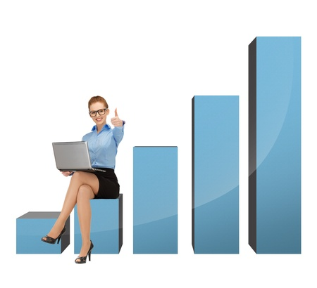 beautiful businesswoman sitting on big 3d chart with laptop photo