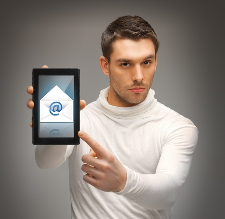 futuristic man: futuristic man pointing at tablet pc with email icon
