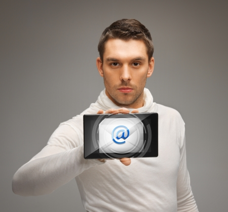 futuristic man: futuristic man holding tablet pc with email icon