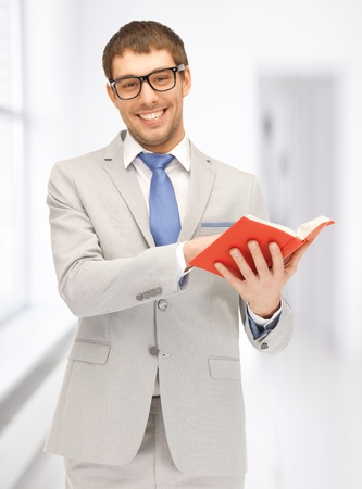 scholar: bright picture of happy man with book