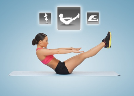 six packs: beautiful sporty woman doing exercises with virtual application