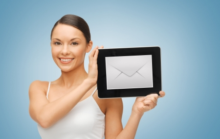 picture of beautiful woman with tablet pc and envelope icon photo