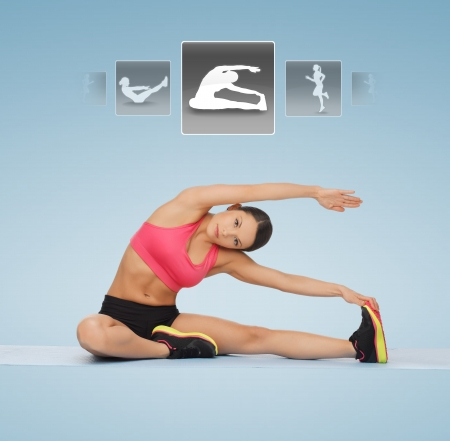 personal decisions: sporty woman stretching on the floor with virtual application