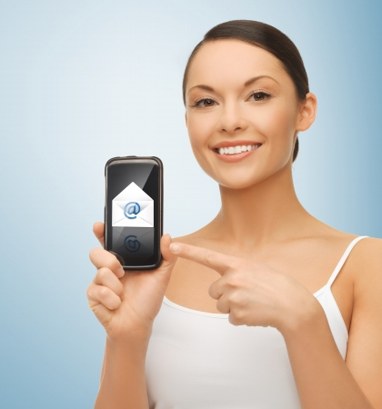 holding smart phone: beautiful woman holding smartphone with email icon