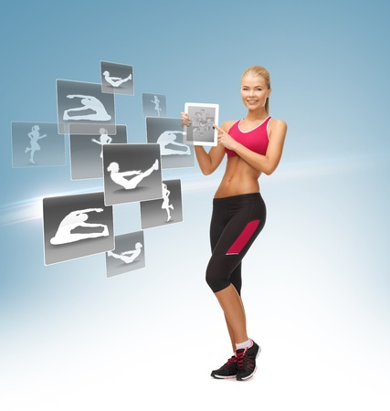 sporty woman pointing at tablet pc and virtual application photo
