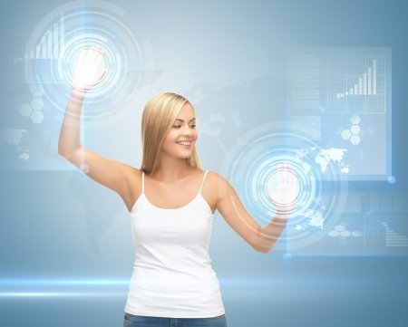 picture of attractive woman working with virtual screen photo