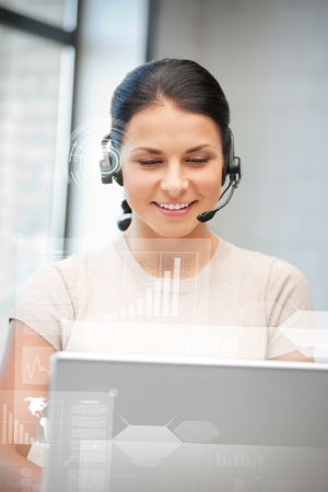 customer assistant: futuristic female helpline operator with headphones and virtual screen Stock Photo