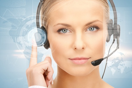 futuristic girl: futuristic female helpline operator with headphones and virtual screen Stock Photo