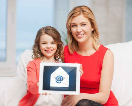 picture of mother and daughter with tablet pc and email icon photo