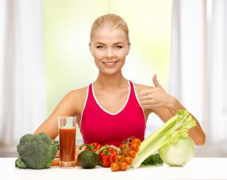 young woman with organic food showing thumbs up photo