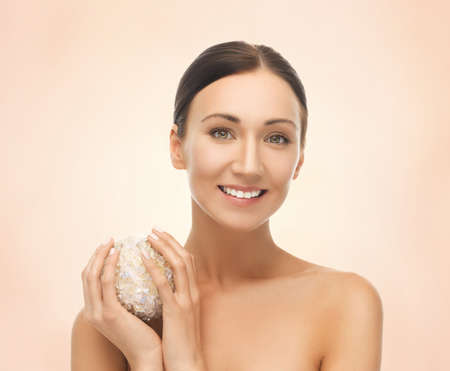 picture of beautiful woman with salt ball for bathing photo