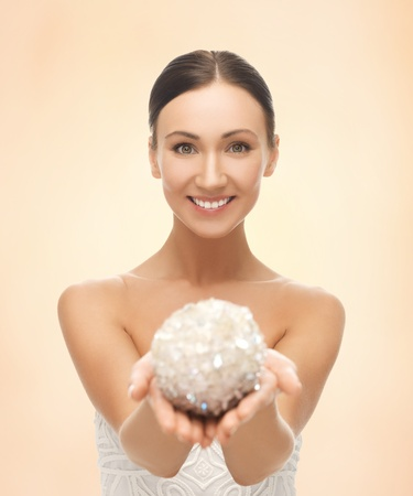 day spa: picture of beautiful woman holding sparkling ball Stock Photo