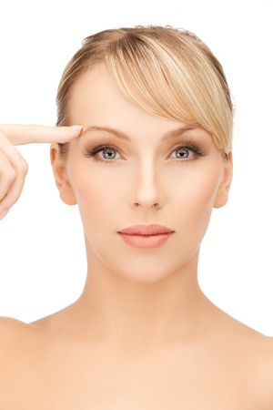 face of beautiful woman pointing at her eyebrow Stock Photo - 19730309