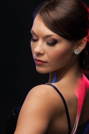beautiful woman in evening dress wearing diamond earrings Stock Photo - 19730377