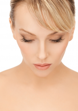face of beautiful woman with blonde hair looking down photo