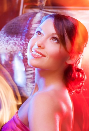 beautiful woman in evening dress with disco ball photo