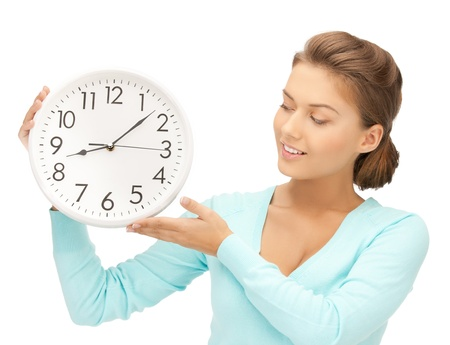 timezone: attractive woman holding wall clock in her hands