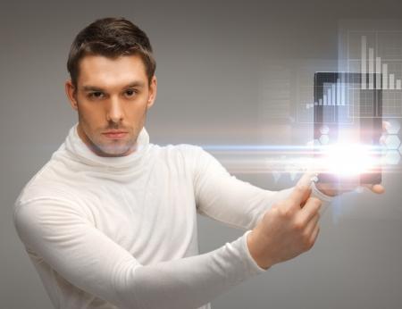 futuristic man: bright picture of futuristic man with tablet pc