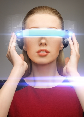 virtual world: picture of beautiful woman with futuristic glasses Stock Photo