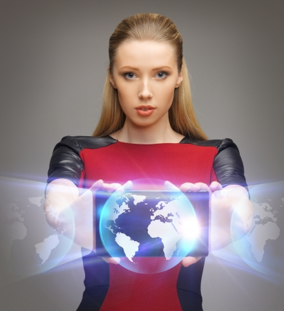 bright picture of futuristic woman with tablet pc photo