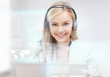 assistant: futuristic female helpline operator with headphones and virtual screen Stock Photo