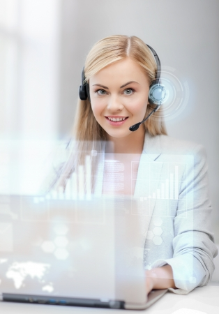 futuristic female helpline operator with headphones and virtual screen photo
