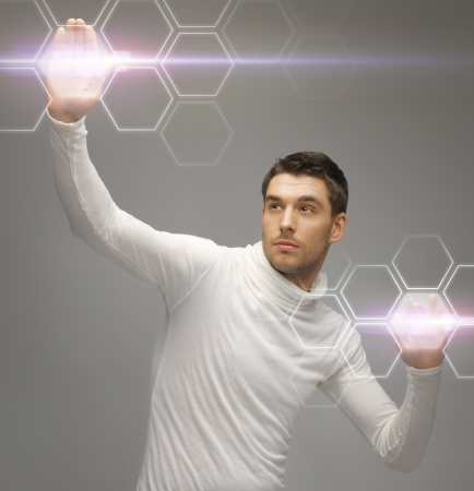 nano: picture of futuristic man working with virtual screens Stock Photo
