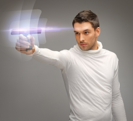 bright picture of futuristic man with gadget photo