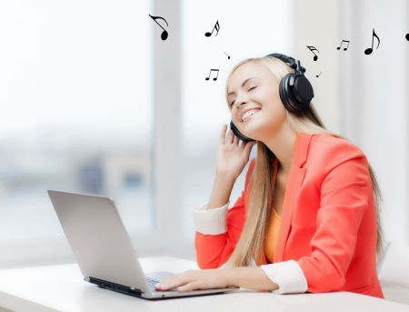 listening to people: happy woman with headphones listening to music Stock Photo