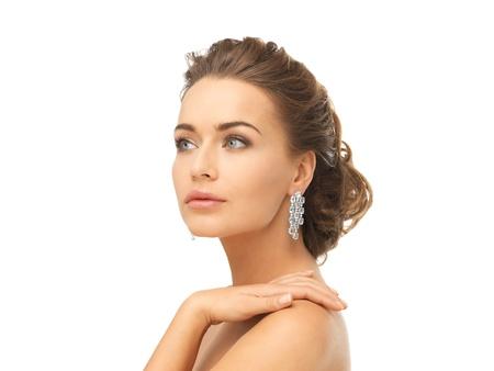 close up of beautiful woman wearing shiny diamond earrings Stock Photo - 19802116