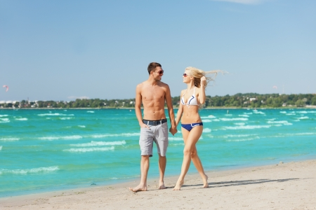 picture of happy couple walking on the beach photo