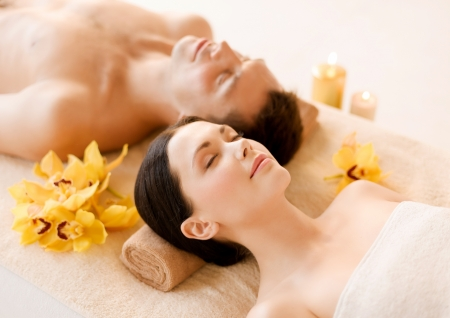 picture of couple in spa salon lying on the massage desks Stock Photo - 19802112