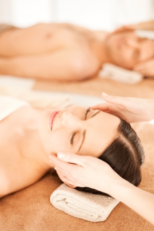 eye massage: picture of couple in spa salon getting face treatment Stock Photo