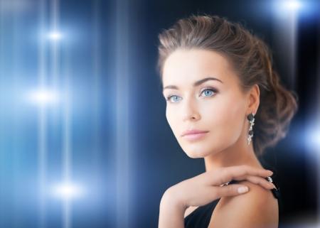 beautiful woman in evening dress wearing diamond earrings Stock Photo - 19802150