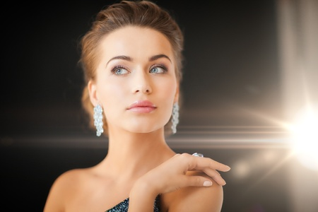 ring light: beautiful woman in evening dress wearing diamond earrings