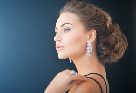 beautiful woman in evening dress wearing diamond earrings Stock Photo - 19802238