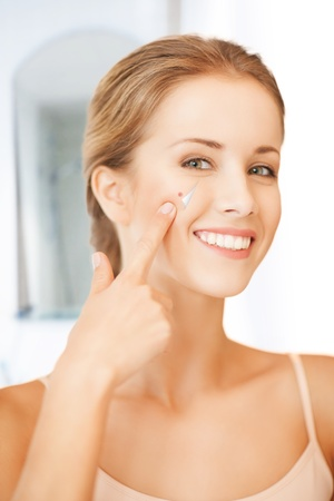 beauty spot: picture of beautiful woman pointing to nose Stock Photo