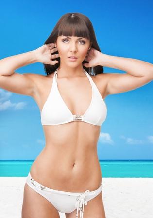 bright picture of beautiful woman in bikini on the beach photo