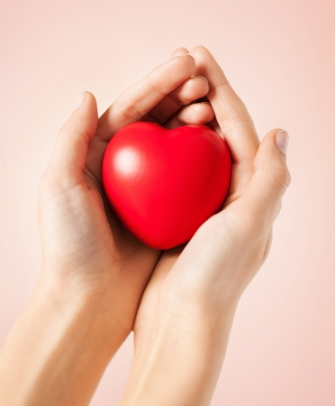 life support: close up of woman hands with heart