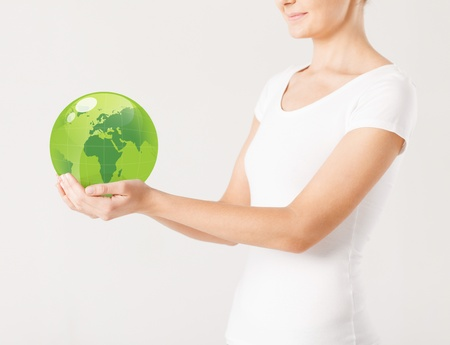 protection hands: close up of woman holding green sphere globe