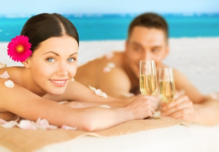 picture of couple on the beach drinking champagne photo