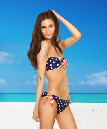 picture of happy smiling woman in bikini with american flag  photo