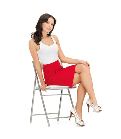 high chair: happy woman in casual clothes sitting on chair Stock Photo