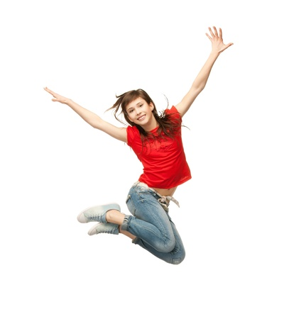 air jump: picture of happy girl jumping in the air