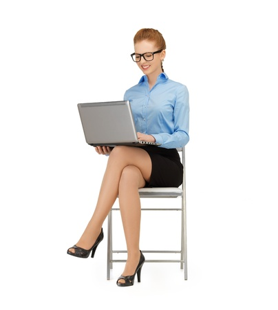 to lap: picture of smiling woman using her laptop computer Stock Photo