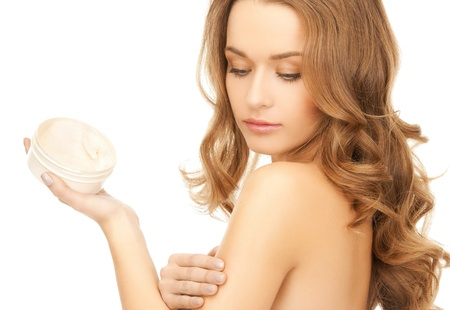 bodycare: beautiful woman applying cream on her skin Stock Photo