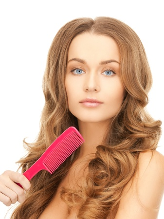 beautiful woman with long curly hair and brush photo