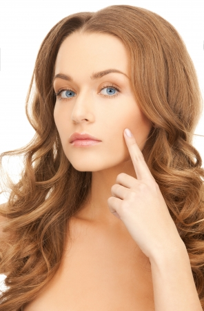cosmetologies: face of beautiful woman pointing at her cheek Stock Photo