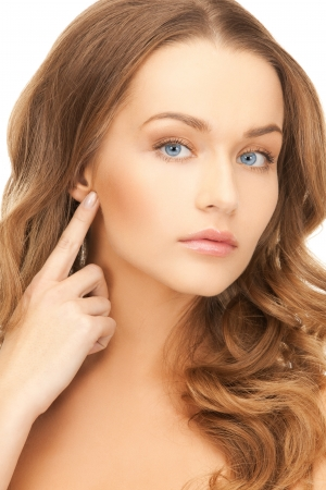 portrait of beautiful woman pointing at her face Stock Photo - 19857297