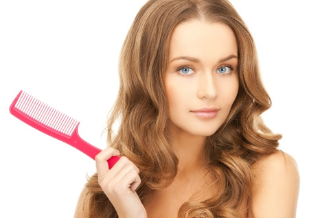 beautiful woman with long curly hair and brush
